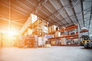 Large warehouse with shelves and palettes