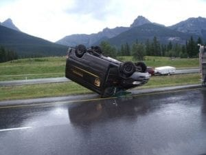 A UPS Van Is Upside on the Side of The Road