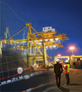 2 men observing a shipping container crane